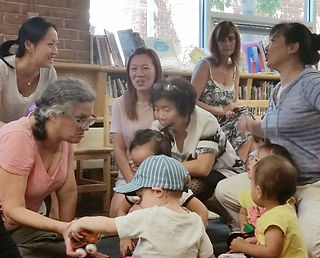 Image of children and caregivers at the Tenafly Public Library
