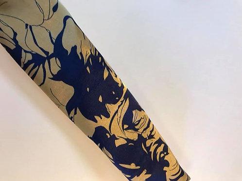 Tan w/ blue floral swirls