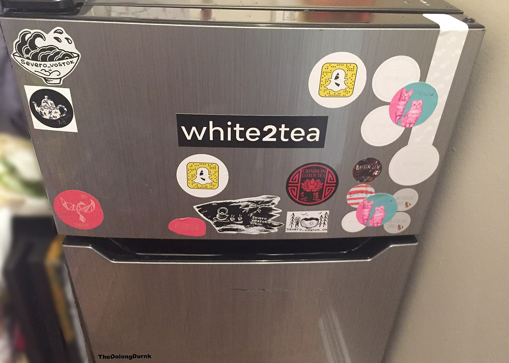 Outside the pumidor covered in multiple tea company stickers!