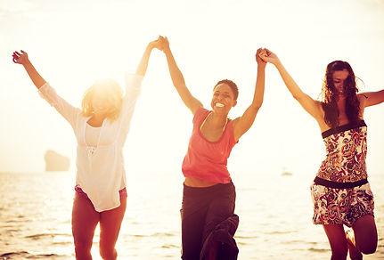 Women Dancing On Beach.jpg
