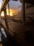 Sunset view off the side of a boat