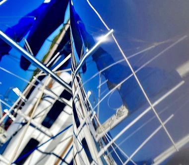 Beautiful reflection off sailboat gel coat