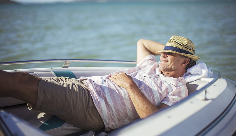 Man peacefully relaxing on his boat