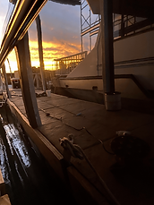 Sunset reflection off cabin boats hull