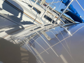 Sailboat with mirror reflection