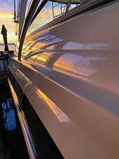 Cabin boat polished to a mirror finish reflecting the sunset