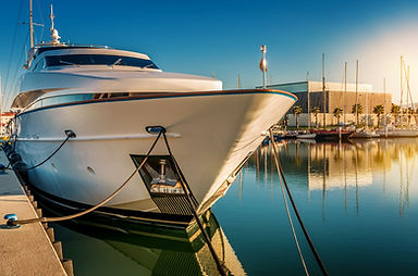 Large yacht tide to the docks in beautiful water with the sun shinning.
