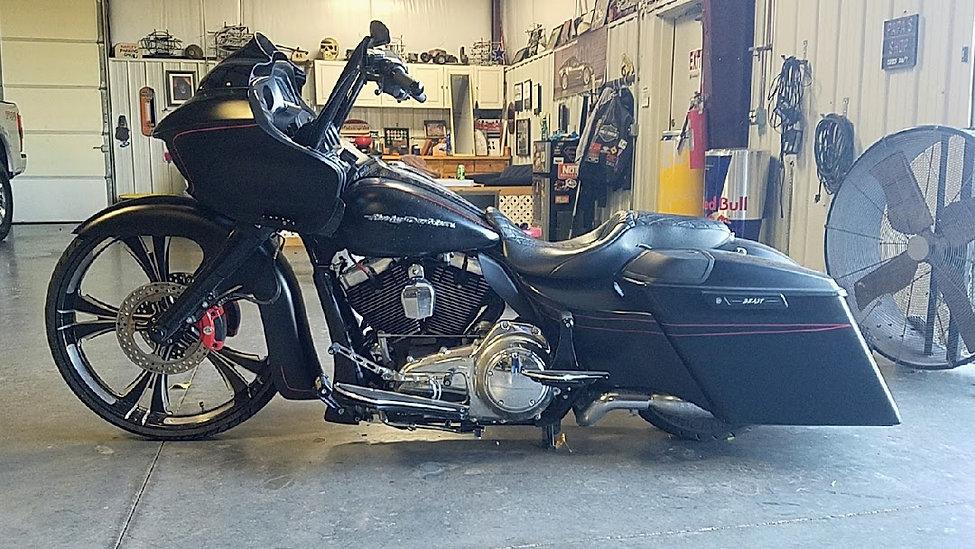 black motorcycle being repaired in wicked metal design shop