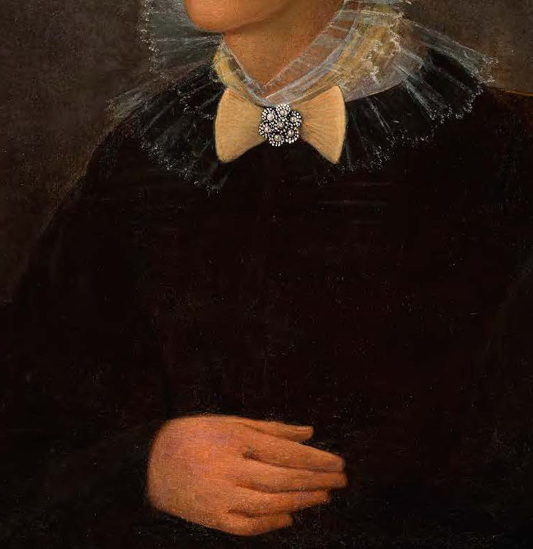 A narrow cropped image of a painting of a Black woman's torso in a black dress with a lace collar and jeweled bow. Her hand rests on her belly.
