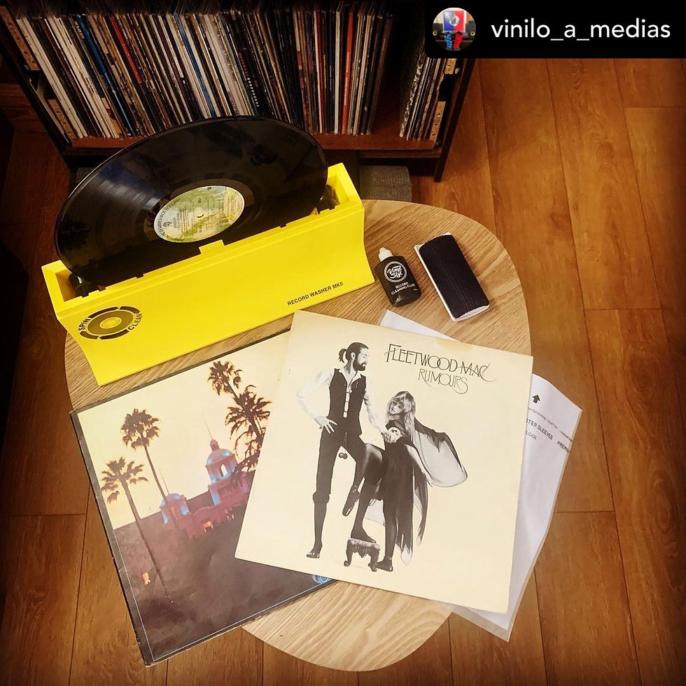 A photo of records on a wooden floor. Submission by Juan Francisco González.