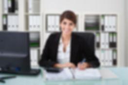 bigstock-Female-Accountant-Writing-On-D-