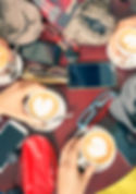 Group of friends drinking cappuccino at