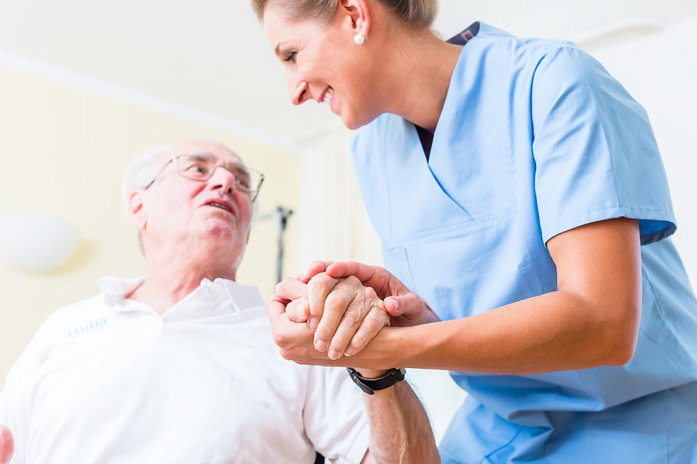 16280732-nurse-holding-hand-of-senior-ma