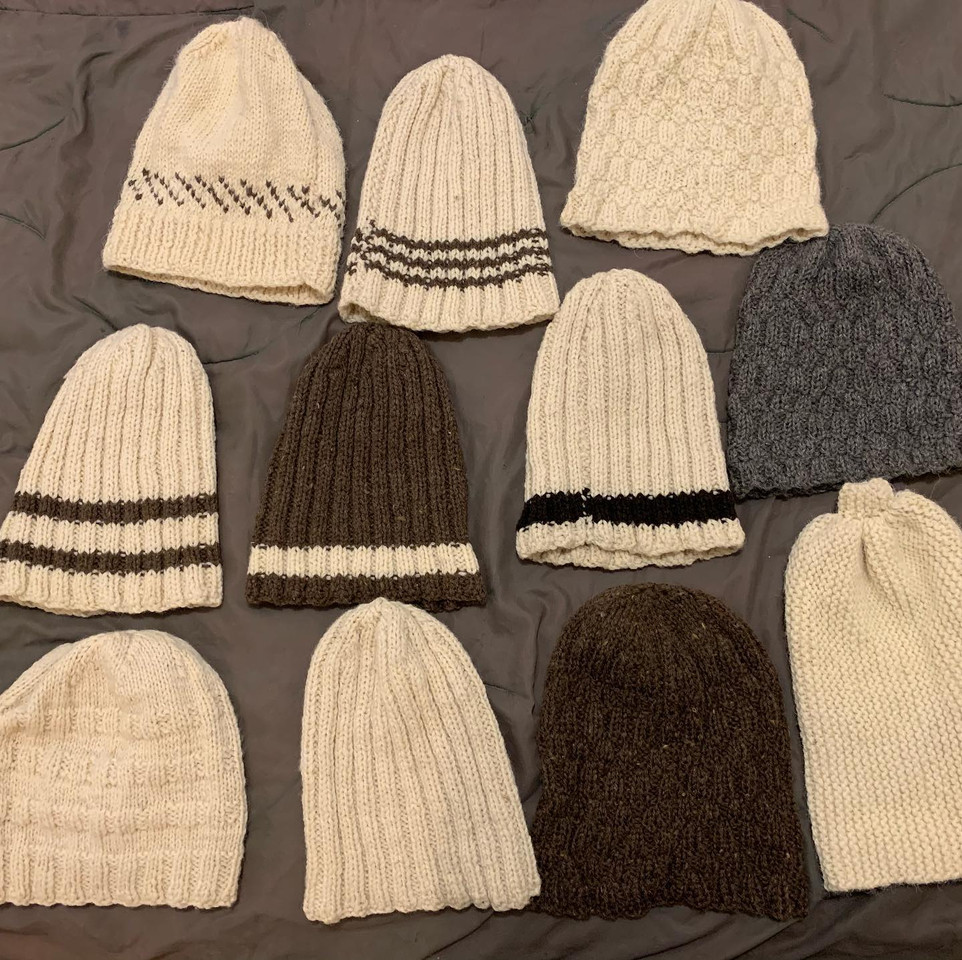 One of a kind hand knit wool hats. Selection varies.
