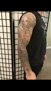 Soft , Realistic black and grey arm sleeve by tattoo artist Bella, female award winning Canadian tattoo artist, in Kelowna Bc Canada.
