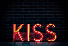 red-kiss-neon-light-signage-on-dark-lit-