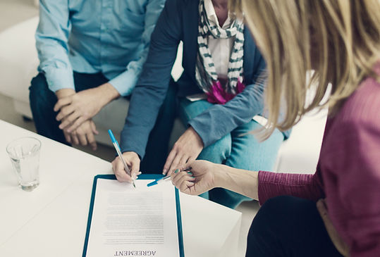 Insurance Agent and Customer signing contract