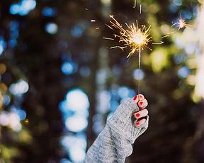 Pretty hand holding sparkler