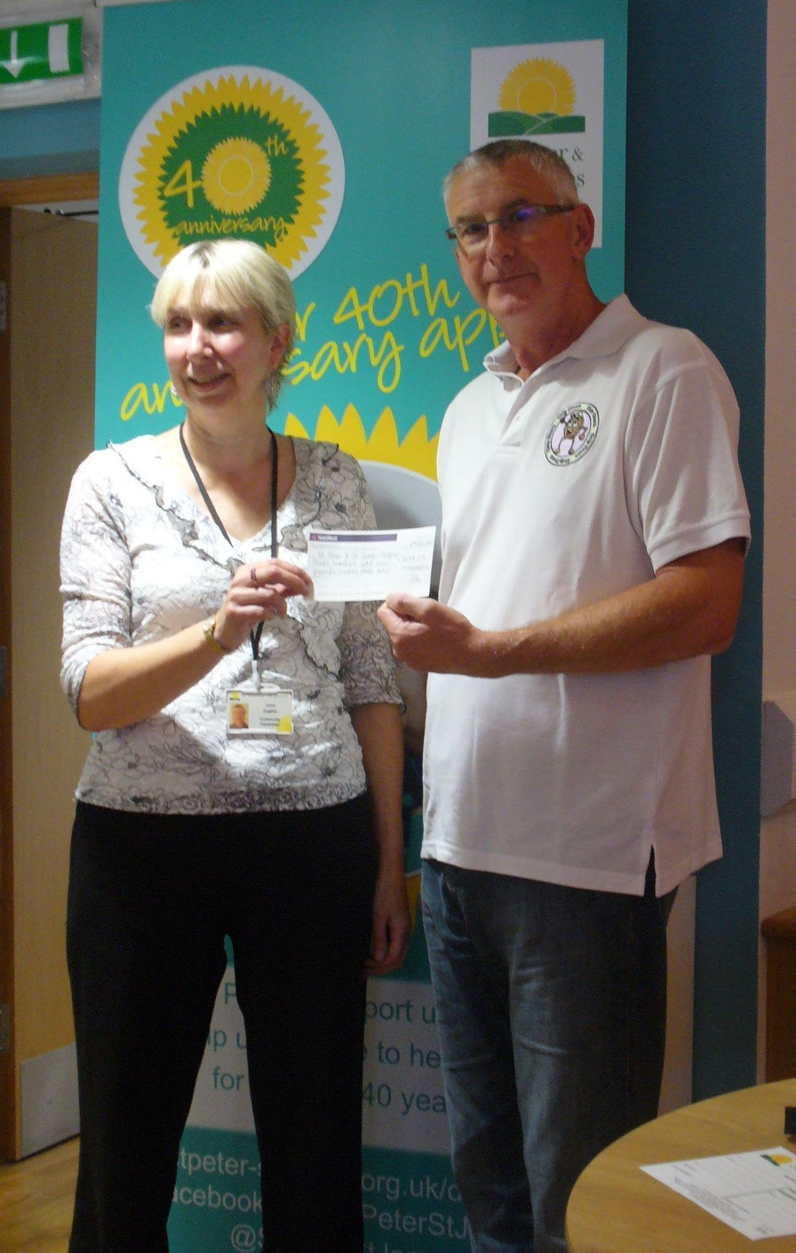 Chip Chuck donating funds to St Peter and St James Hospice