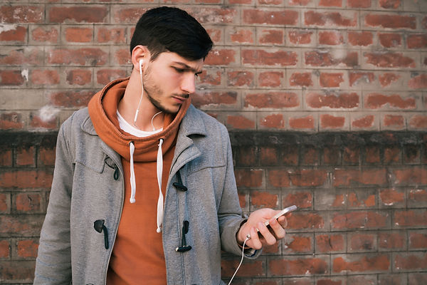 young-man-using-mobile-phone.jpg