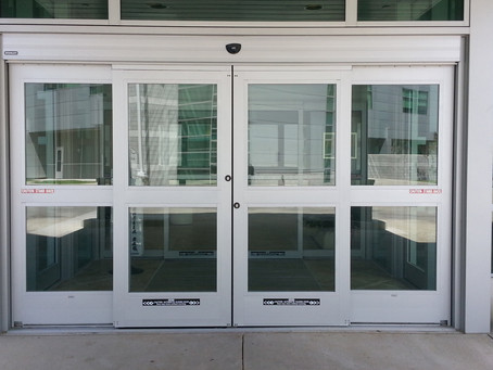 How fast should automatic doors open?