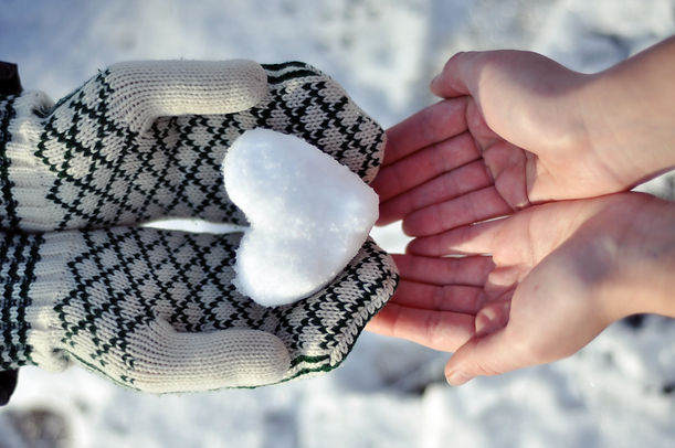 Hands holding a snow heart and sharing love.jpg