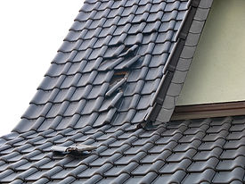 Storm damage - slipped roof tiles after