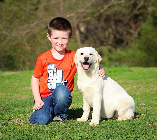 Boy with White Labrador Puppy