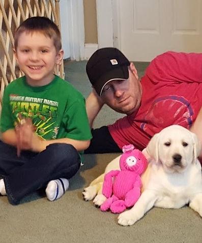 Boy with Father and English Labrador Retriever Puppy