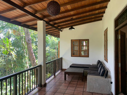 The Balcony overlooking the forest and organic vegetable Farm