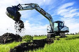 Bobcat Excavator picking up dirt