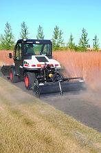 Bobcat Toolcat mowing grass