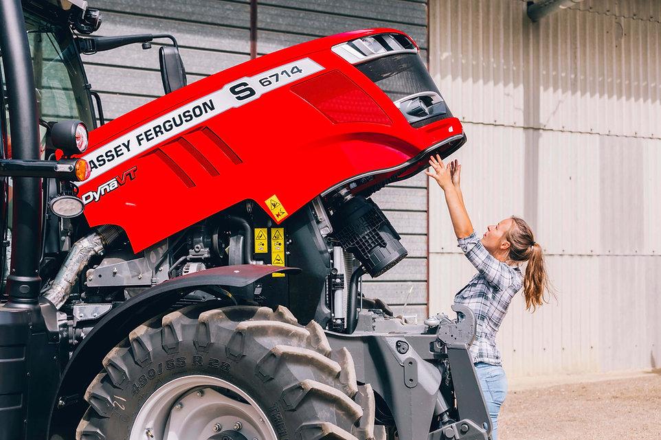 woman-with-mid-range-tractor-massey-ferguson
