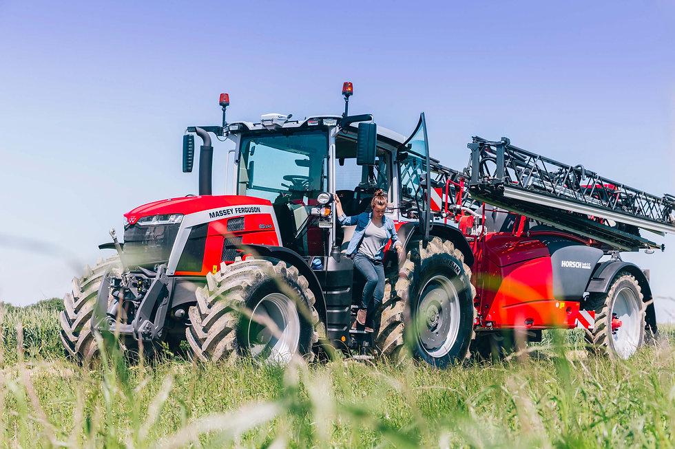women-getting-off-tractor-massey-ferguson-8s-transport-horsch-sprayer