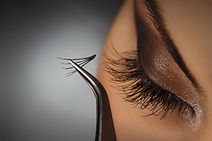 Beautiful young woman eyelash extension.