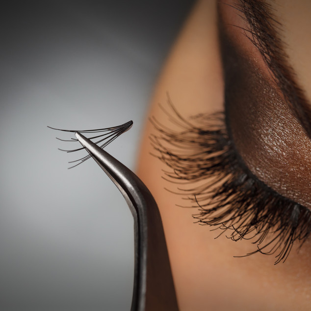 Beautiful young woman eyelash extension.