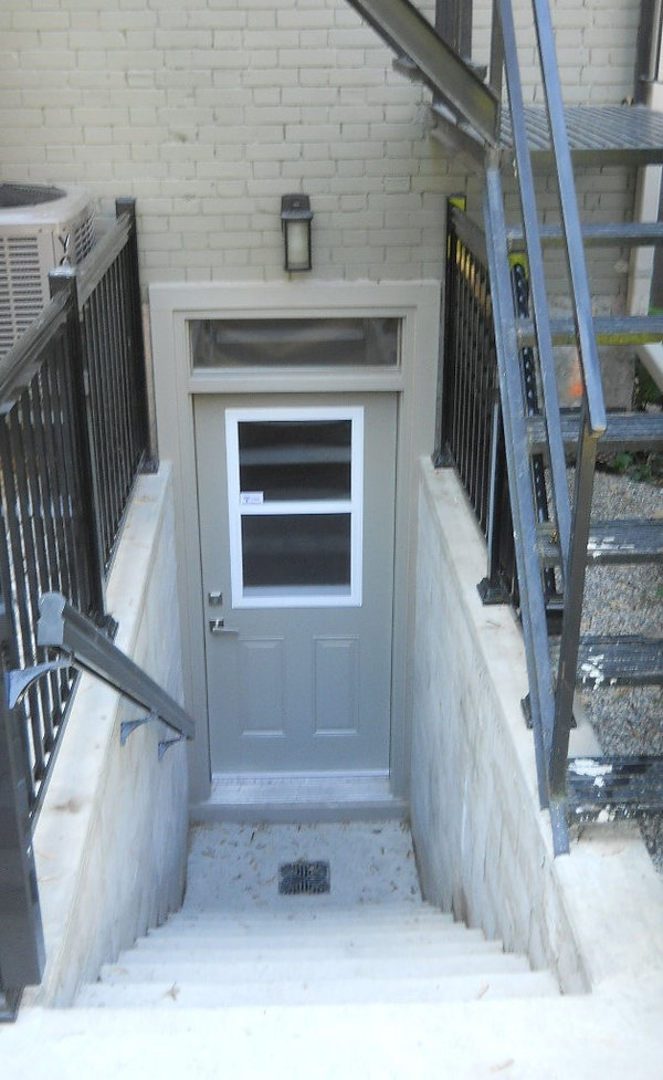 Basement walkouts, concrete retaining wall, basement entrance, basement lowering, egress window, basement entryway