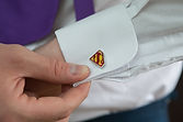 Groom shows off his superman cufflinks