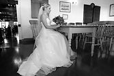 Bride waits patiently and a table before the wedding ceremony