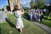 Party guest takes over the group shot outside the church