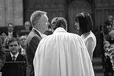 image of bride and groom in a church taking their vows