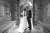 image of bride and groom in a church doorway