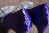 image of the brides wedding shoes in purple