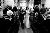 image of bride and groom in a church after the ceremony