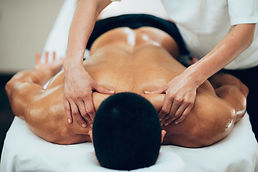 Sports massage. Therapist working with s