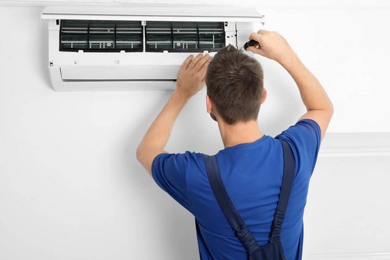 air-conditioner-repair-maintenance-1068x