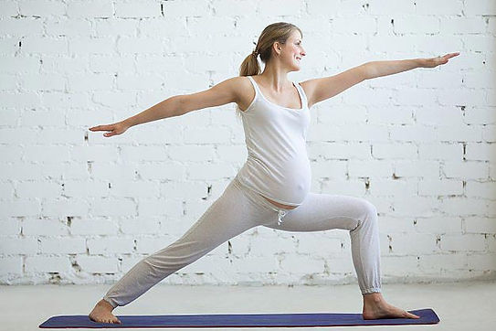 pregnant-young-woman-doing-prenatal-yoga