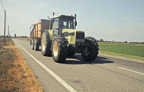 yellow-tractor-in-asphalt-road-771146.jp