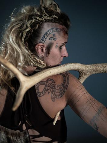 Shoulder, arm, skull tattoos.