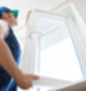 Professional handyman installing window